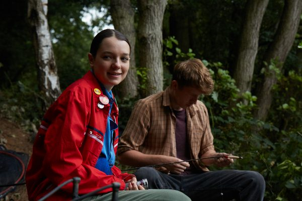 KEY STILL - Esme Creed-Miles and Tom Varey in POND LIFE (fishing)