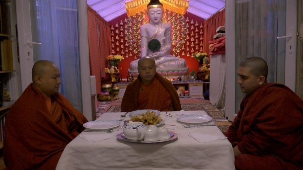 monks sitting to eat